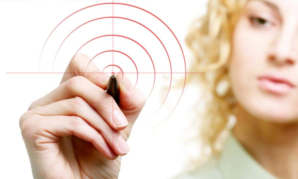 blonde woman drawing a target with a marker
