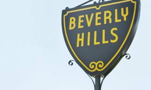 city of beverly hills sign with light blue sky