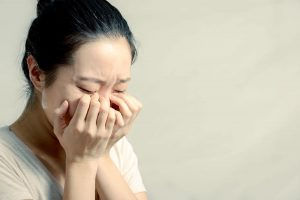 asian woman in tears after breast cancer diagnosis