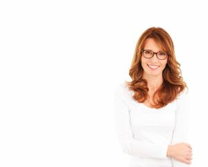 brunette woman with glasses smiling