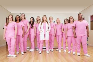 pink lotus breast center team in pink outfits