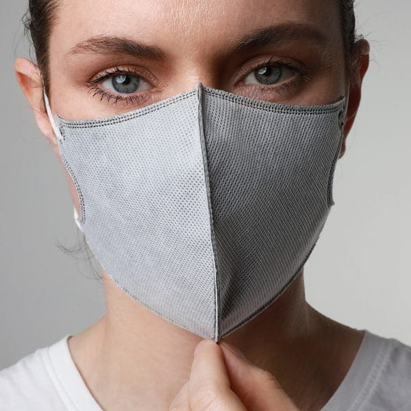 woman with gray mask thinking about covid